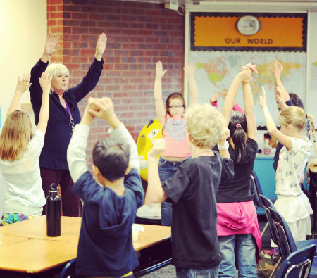 A Lake County Intermediate teacher leads her class through a brain booster activity.