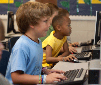 Kids using the computer in school.