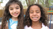 Two elementary aged girls smiling